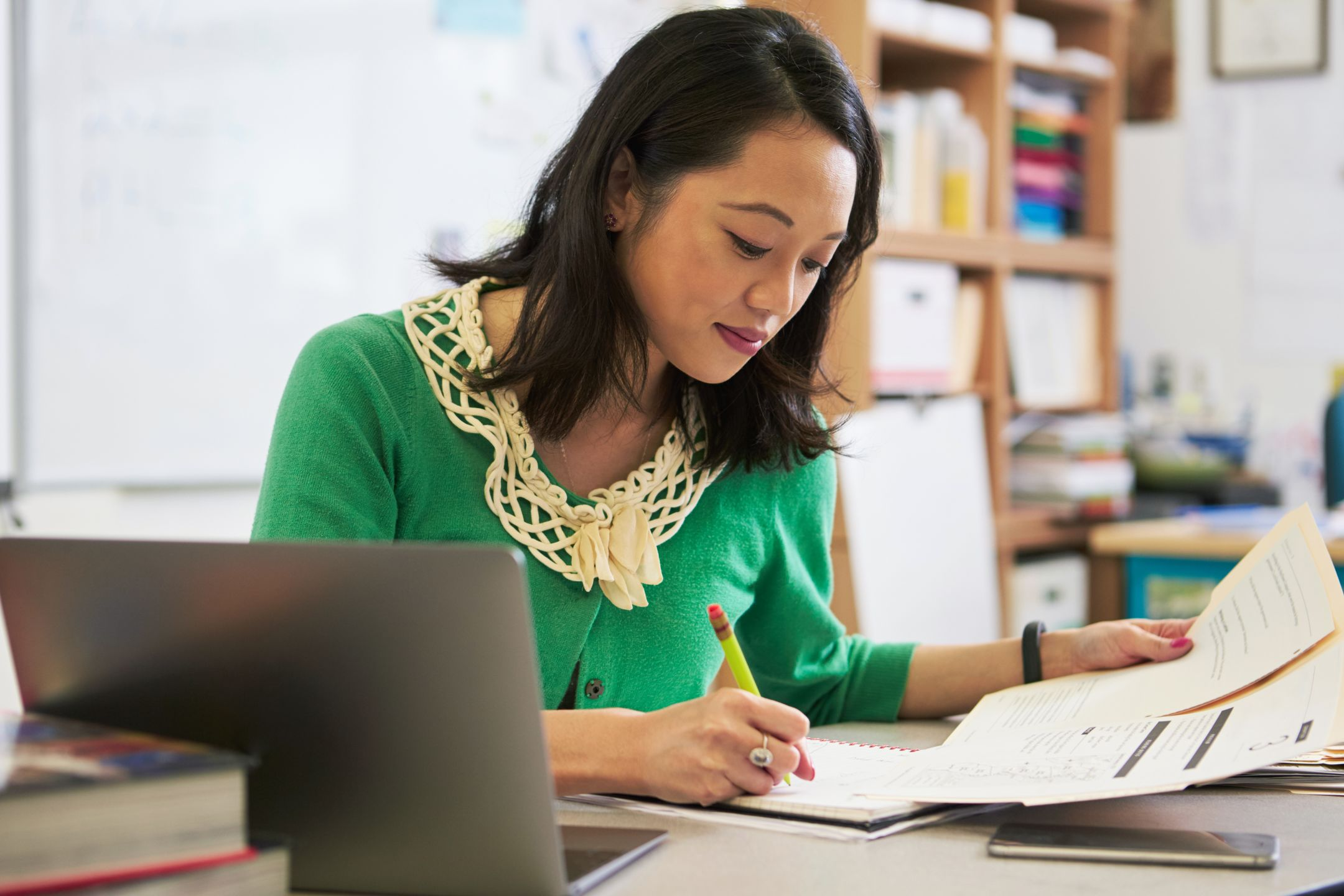Teacher working in classroom