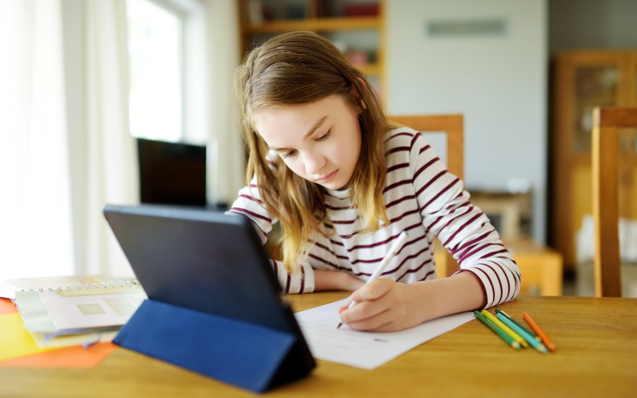 Girl working with tablet