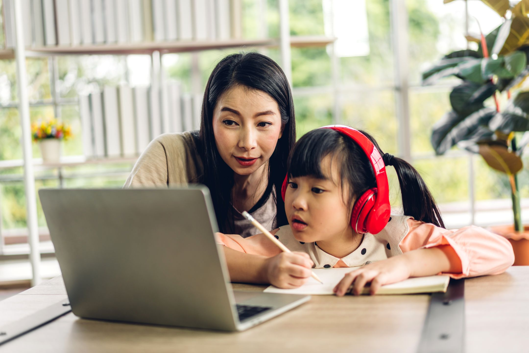 Parent and child using laptop
